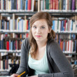 Foto Stock: Female student studying