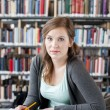 Stock Photo: Female student studying