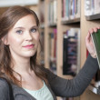 Stock Photo: Female student in library