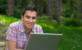 Young men with lap-top — Stock Photo