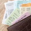 Stock Photo: Leather Wallet Filled With Receipts