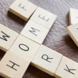 Stock Photo: Wooden Tiles In Crossword Shape Spelling Words Home Work And Lif