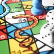 Close Up Of Snakes And Ladders Board - Stock Photo