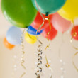 Group of coloured party balloons - Stok fotoğraf