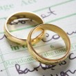 Gold Wedding Rings On Marriage Certificate — Stock Photo
