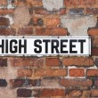 Rusty Metal High Street Road Sign On Brick Wall — Stock Photo