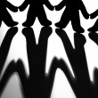 Black And White Image Of Silhoutted Figures Joining Hands — Stock Photo