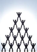 Model Figures Forming Pyramid — Stock Photo