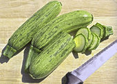 Zucchini on a wooden cutting board — Stock Photo