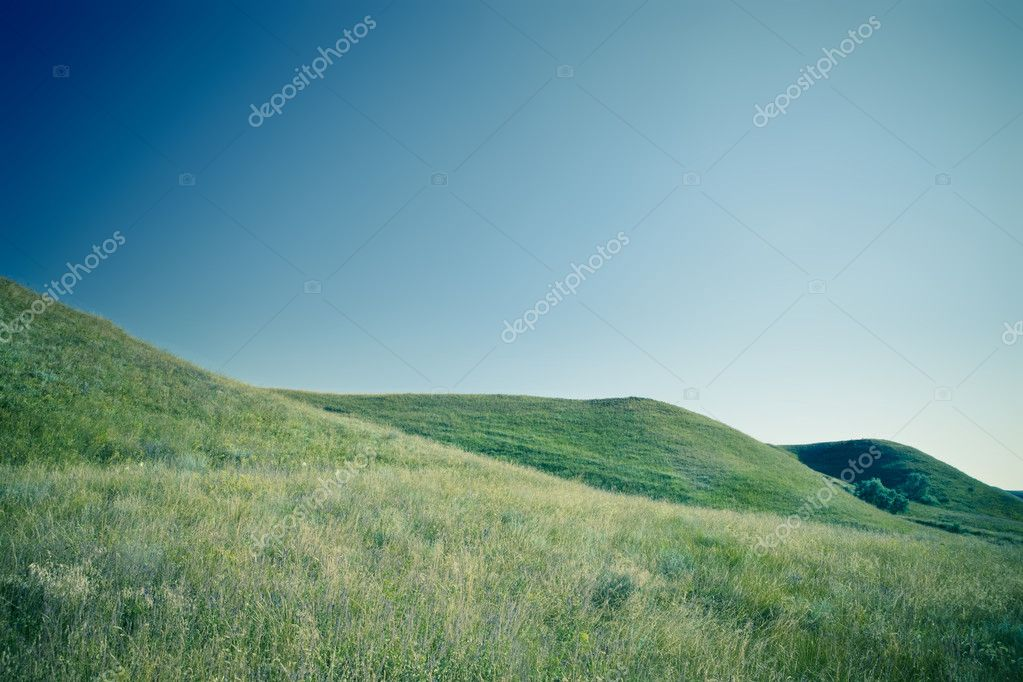 A photo of green hills and blue sky — Stock Photo #10029675