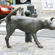 Sculpture of a pissing dog — Stock Photo