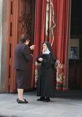 Conversation with a nun — Stockfoto
