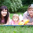 Stock Photo: Young family lying