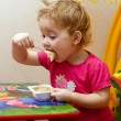 Child is eating — Stock Photo
