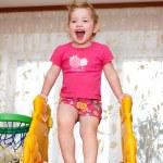 Child girl on slide — Stock Photo