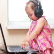Baby girl working on the laptop — Stock Photo