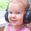 Baby listening to music — Stock Photo #10033459