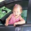 Foto Stock: Baby driving a car