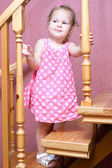 Girl in a pink dress up the stairs — Foto Stock