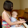 Baby play the piano — Stock Photo