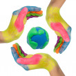 Colorful hands making a circle around earth globe — Stock Photo