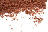 Scattered grated chocolate — Stock Photo