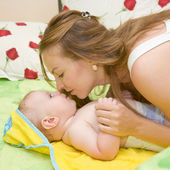 Mother kissing baby — Stock Photo