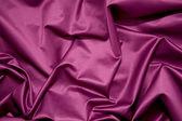 Folds of glossy smooth purple satin fabric — Stock Photo