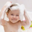 Little child is washing her hair in bath — Stock Photo #9862190