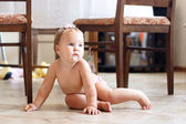 Baby sitting on the floor — Stok fotoğraf
