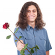 Man is giving a rose — Stock Photo