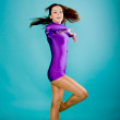 Teen girl wearing a violet gymnastic clothes dancing. — Stock Photo #9928735