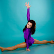 Teen girl wearing a violet gymnastic clothes dancing. — Stock Photo #9928760