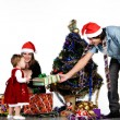 Father giving little daughter a Christmas gift — Stockfoto