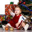 Baby sitting under a Christmas tree — Stockfoto #9928767