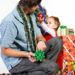 Father giving little daughter a Christmas gift — Stock Photo #9928773