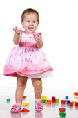 Beautiful baby in pink dress — Stock Photo