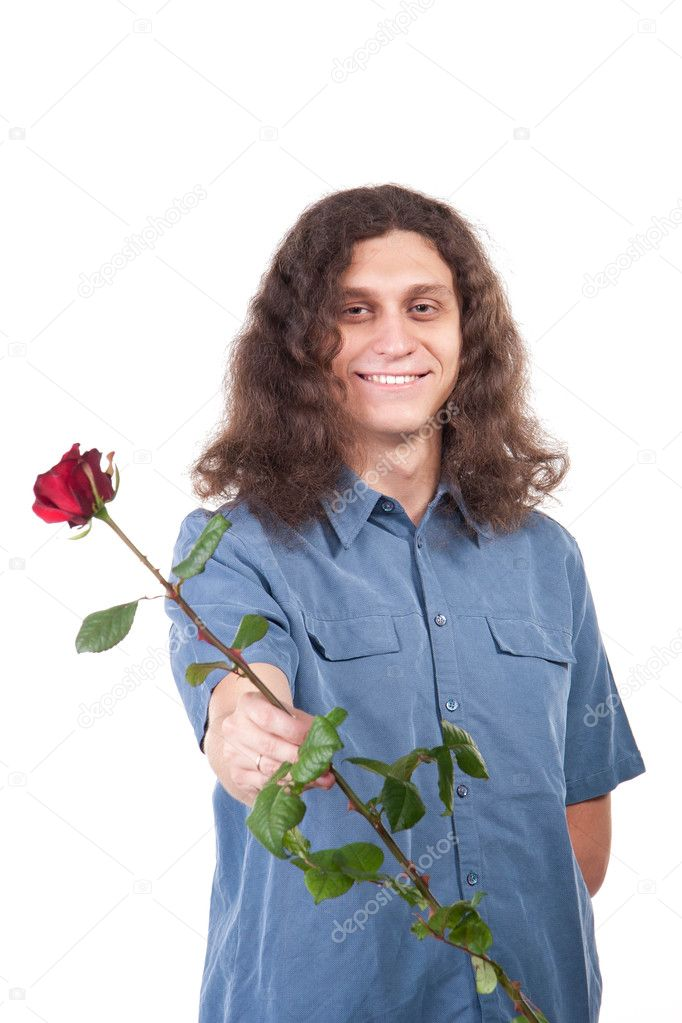 The cute man with long hair is giving a rose. Isolated on white  Stock Photo #9928541