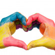 Colored hands showing a heart shape — Stock Photo