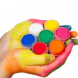 Colored hand holding set of paints — Stock Photo