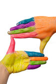 Colored hands forming finger frame — Stock Photo