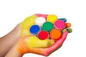 Colorido mão segurando o conjunto de tintas — Fotografia Stock