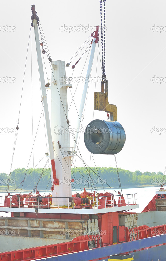 Rolls of steel sheet in the harbor — Stock Photo #10103736