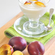 Yogurt and plums fruit — Stock Photo