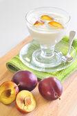 Yogurt and plums fruit — Stock Photo
