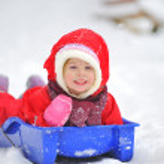 Little girl on sleigh — Stock Photo