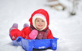 Little girl on sleigh — Stock fotografie