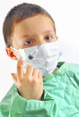 Doctor boy with protective mask preparing to inject — Stock Photo