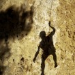 Climber in the shadow — Stock Photo