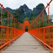 Red bridge over song river, vang vieng, laos — Stock Photo